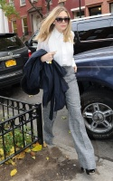 Elizabeth Olsen grey trousers.jpg