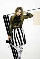 Hannah Murray striped skirt and diamond tights.jpg